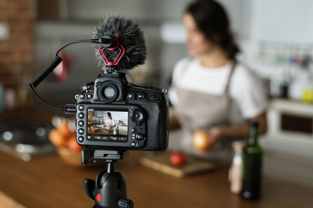 female-vlogger-recording-cooking-related-broadcast-home_53876-14733.jpg